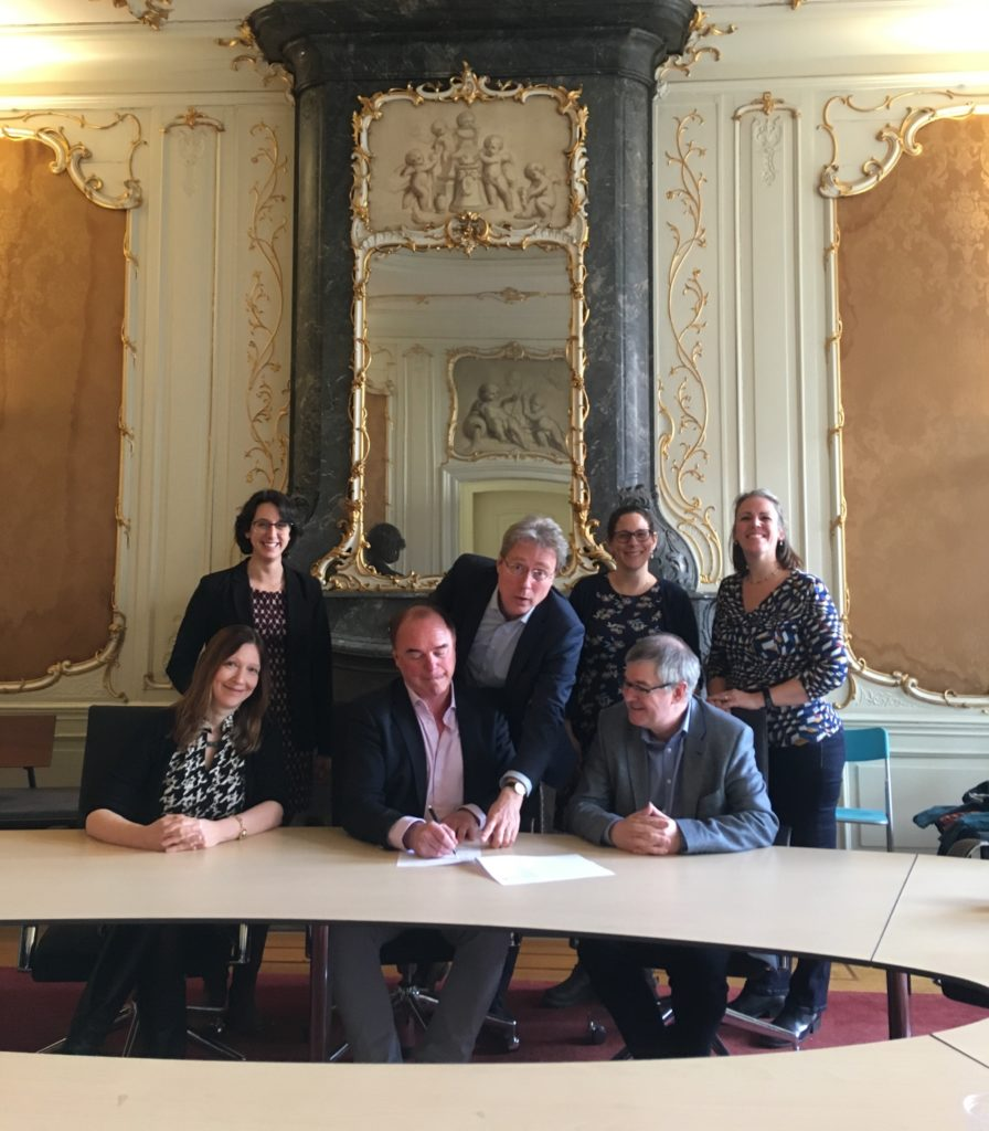 A photograph of the senior staff signing the Memorandum of Understanding at Utrecht University
